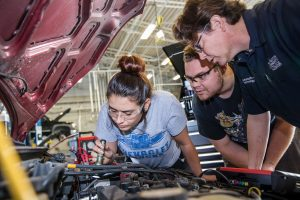 ACC auto tech students work on a car