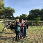 2018 GTR participants at the ranch in front of a longhorn