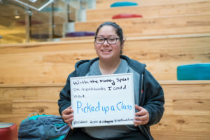 Student holding sign